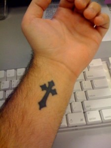 solid-black-cross-tattoo-on-wrist