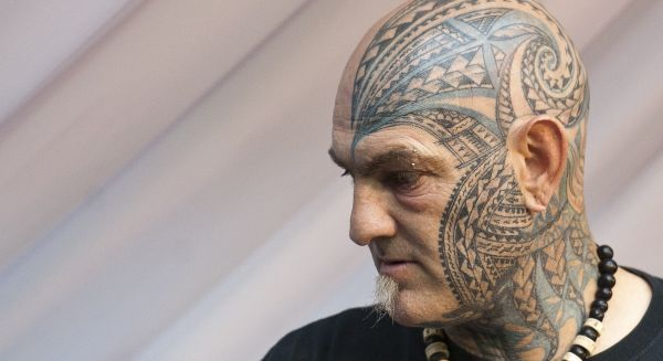 A picture shows a man with facial tattoo