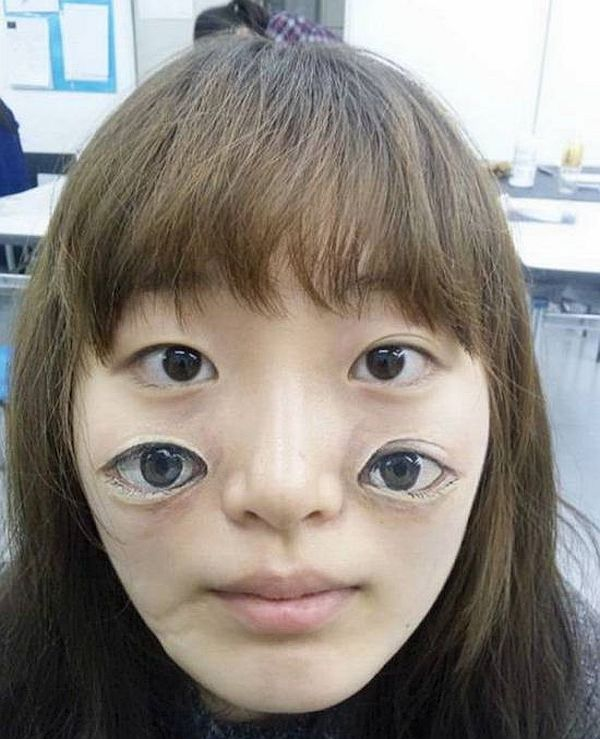 Eyes on face tattoo
