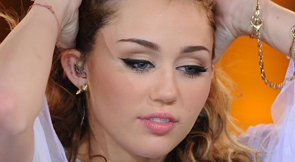 Miley Cyrus ear tattoo