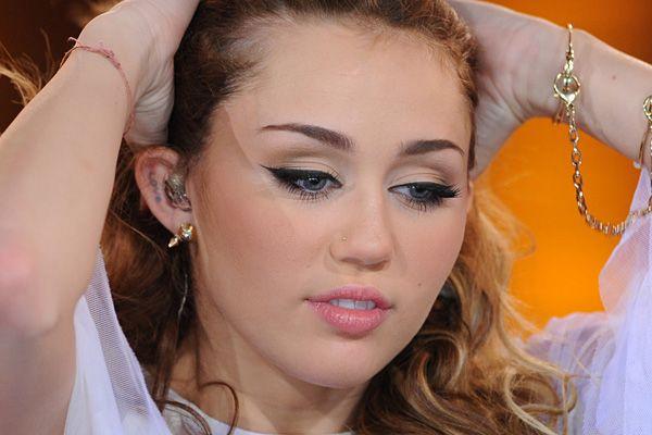 Miley Cyrus ear tattoo