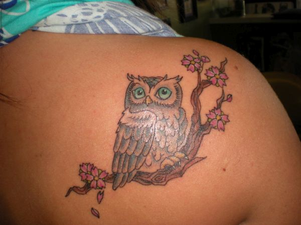 Owl and landscape tattoos