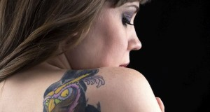 Photo of woman with tattoo from back