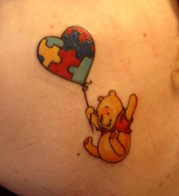 Winnie the Pooh with a heart puzzle