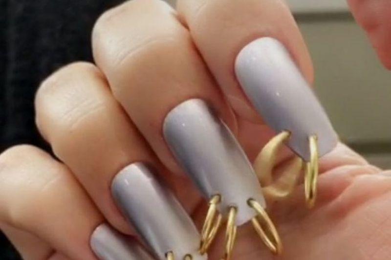 Kim Kardashian nail piercing